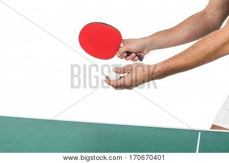 Male athlete playing table tennis on white background