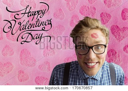 Composite image of happy nerd man with lipstick mark and valentines day text