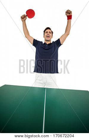 Happy male athlete posing after victory on white background