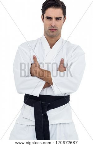 Portrait of fighter standing with arms crossed on white background
