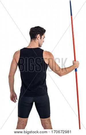 Rear view of male athlete holding javelin on white background