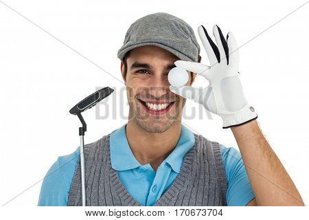 Golf player showing golf ball and holding golf club on white background