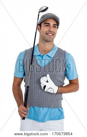 Happy golf player standing with golf ball and golf club on white background