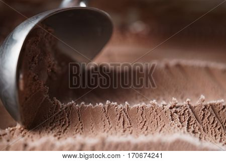 scooping chocolate ice cream close up shot, shallow focus