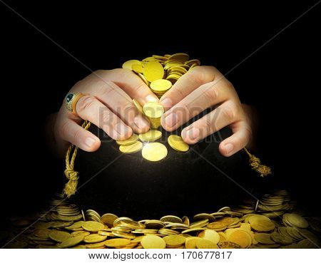 greedy hands guarding the bag of gold coins