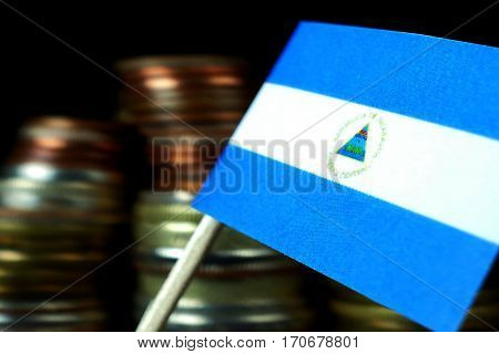 Nicaragua Flag Waving With Stack Of Money Coins Macro