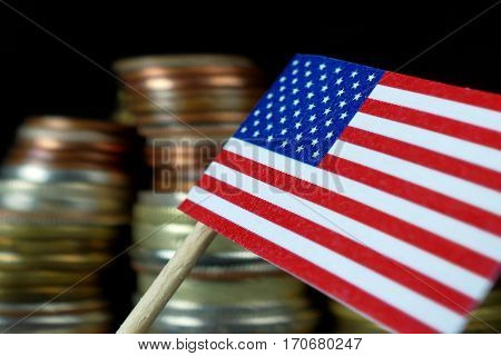 Us American Flag Waving With Stack Of Money Coins Macro