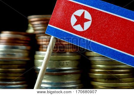 North Korea Flag Waving With Stack Of Money Coins Macro