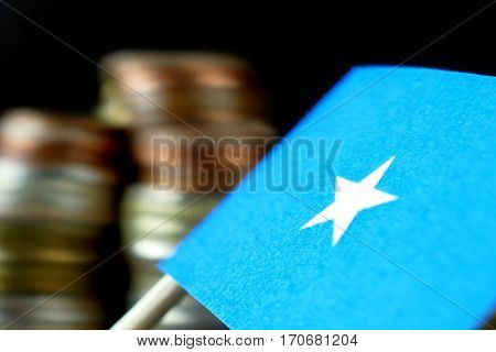 Somalia Flag Waving With Stack Of Money Coins Macro