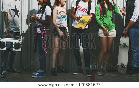 Diverse young people hanging out together
