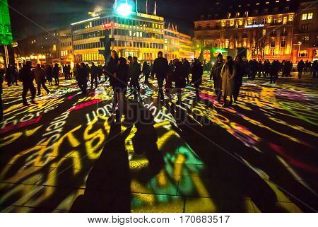 Cologne, Germany - January 16, 2017: Light installation around the cologne cathedral, spectators standing on the square, looking at the projections