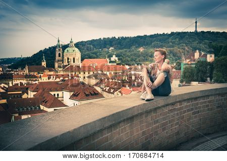 women sitting on wall in Prague. top view of the city