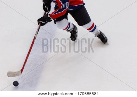 Ice hockey player with puck