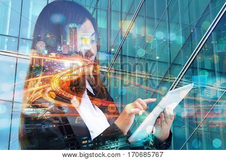 Double Exposure Of Business Woman Use Wireless Digital Mobile Tablet With Expressway Or Highway In M