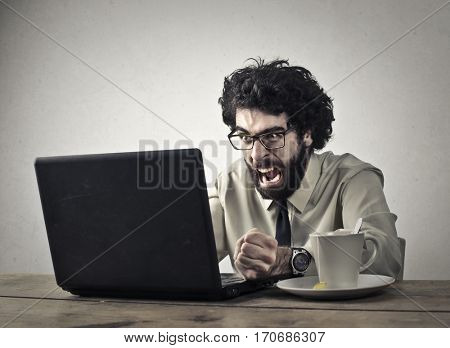 Businessman getting angry about his laptop