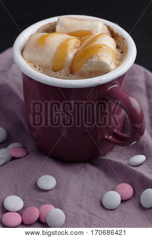 Hot chocolate with marshmallow and caramel sauce