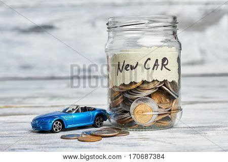 Toy car, money and card. Savings for buying new car.