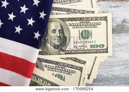 Money and flag of America. National stability and independence.
