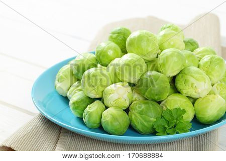 plate of raw Brussels sprouts - close up