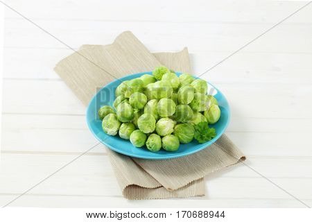 plate of raw Brussels sprouts on beige place mat
