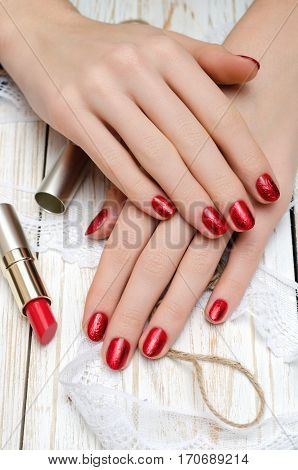Red nails and red lipstick. Manicure and makeup.