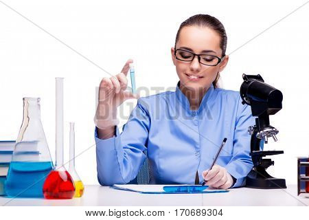 Lab chemist working with microscope and tubes