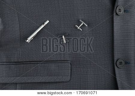 Classic suit cufflinks and tie clip close-up. View from above