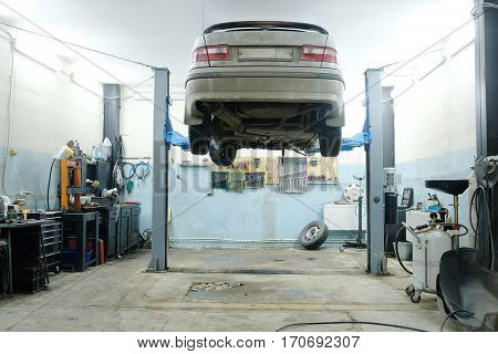 Car on a lift in a car repair station