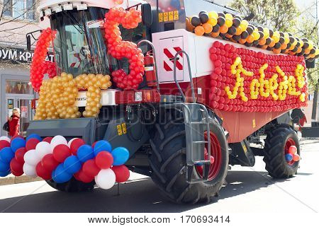 Tyumen, Russia - May 9. 2010: Parade of Victory Day in Tyumen. The combine decorated with balloons participates during the holiday