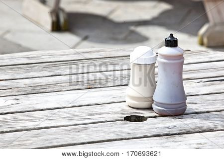 Salt and vinegar bottles on wooden table