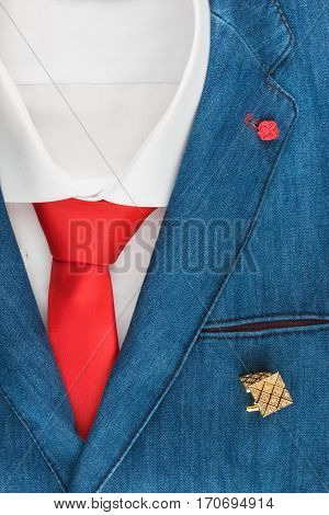 Classic denim suit shirt cufflinks and tie close-up. View from above