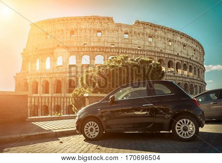 ROME - JANUARY 07: Old retro car on January 07, 2017 in Rome. Black car stay near the Coliseum, symbol of Rome - most popular historical  place of the Italy and the world.