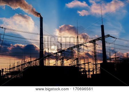 Power Plant during sunrise. Environmental pollution. Factory pipe polluting air