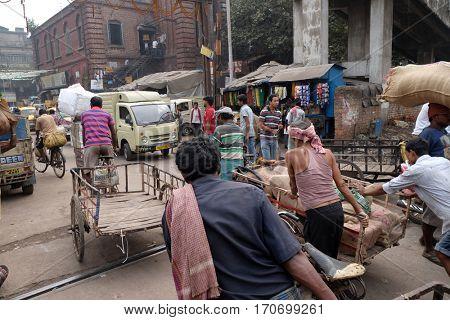 KOLKATA, INDIA - FEBRUARY 10: Pedestrians, rickshaws, cyclists on railroad crossing in Kolkata, India on February 10, 2016.