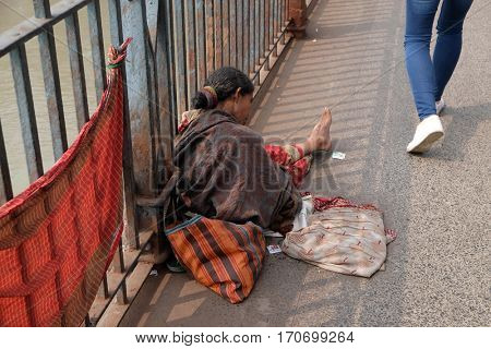 KOLKATA, INDIA - FEBRUARY 10: Beggars are the most disadvantaged castes living in the streets, 42% of India falls below the international poverty line of $1.25 a day. Kolkata, on February 10, 2016.