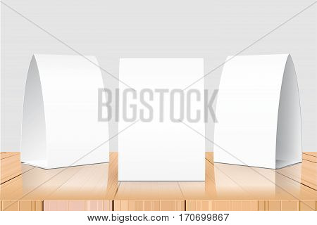 Blank Table Tent isolated on woden table background. Paper vertical cards on white background with reflections. Front, left and right view. Vector illustration.
