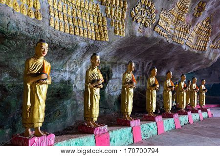 Buddhist statues row in the Saddar cave, Hpa-an, Myanmar