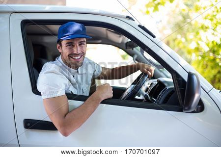 Portrait of of smiling delivery man sitting in van