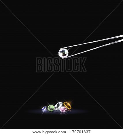 black background and iron tweezers with jewel colored crystals