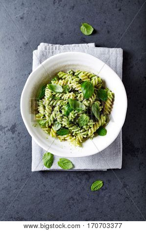 Fussili pasta with basil pesto and herbs