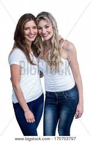 Happy female friends standing together with arms around on white background