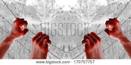 Artistic blood tortured hand grasping desperately barbed wire poster