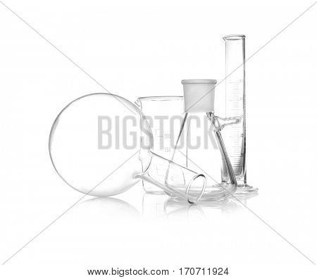 Clean laboratory glassware on white background