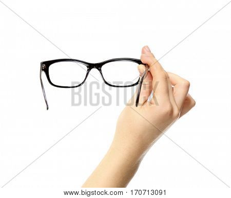 Woman holding spectacles on white background