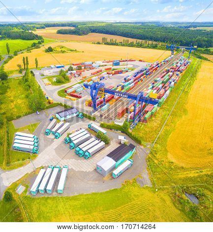 NYRANY, CZECH REPUBLIC - JULY 16, 2016: Aerial view of container terminal on a railroad with open storage area 50 000sqm. Terminal has a capacity of 40 trucks/day. European transportation industry.