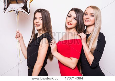 Three Lovely Young Women In Night Dresses On Side And Holding Star Shaped Balloons Over White