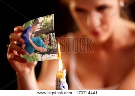 Broken heart woman. Couple break up. Sad bride on unhappy wedding. Woman and groom quarrel. Girl burns in fire candle family pictures. Portrait crying female.