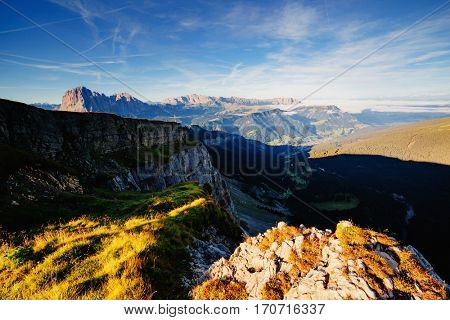 Aerial view of the alpine valley in sunlight. Great and gorgeous morning scene. Location place National Park Gardena, Seceda peak, Dolomiti group. Tyrol, Italy, Europe. Beauty world. Drone photography
