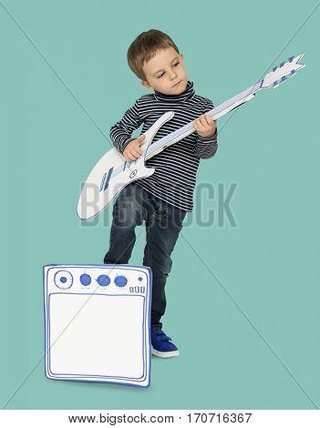 Caucasian Little Boy Playing Papercraft Guitar