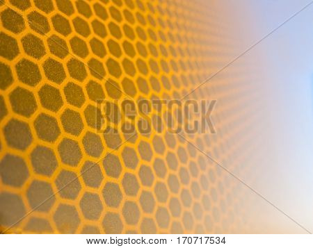 Honeycomb background texture from a reflective surface of a traffic sign
